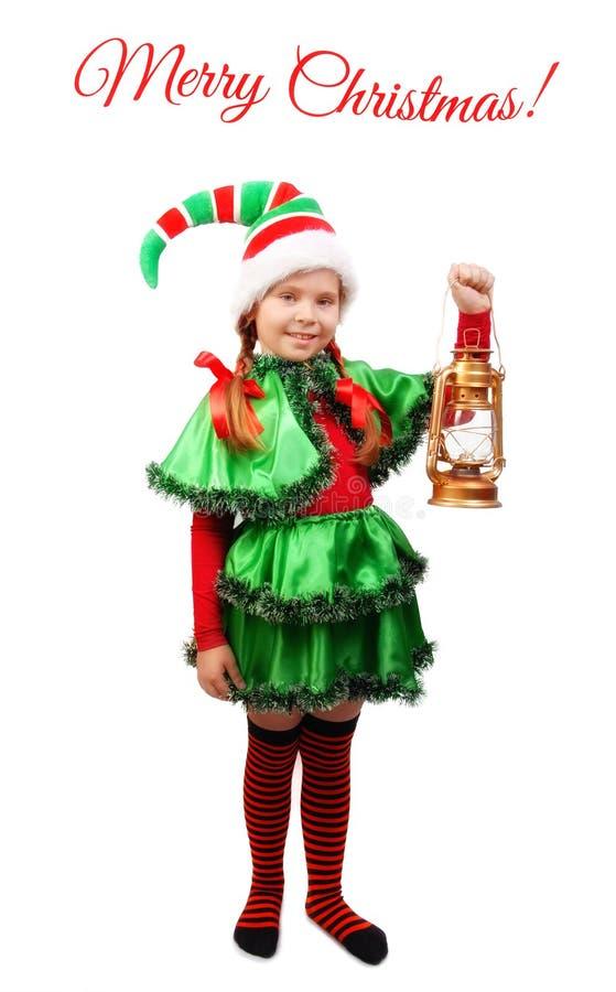 Meisje in kostuum van Kerstmiself met lamp op wit royalty-vrije stock fotografie