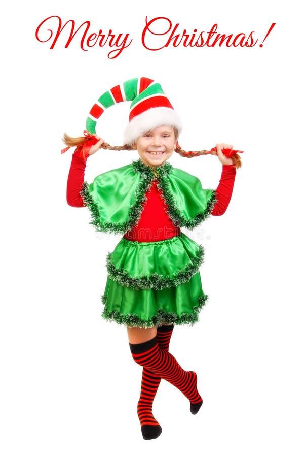Meisje in kostuum van Kerstmiself over wit royalty-vrije stock foto