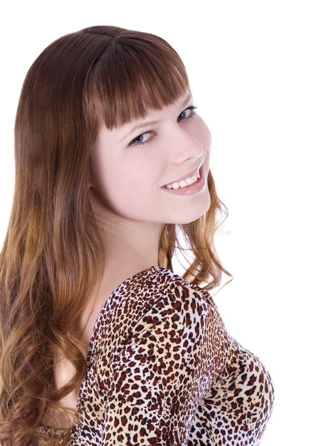 Meisje in luipaardkleding het stellen over wit royalty-vrije stock afbeelding