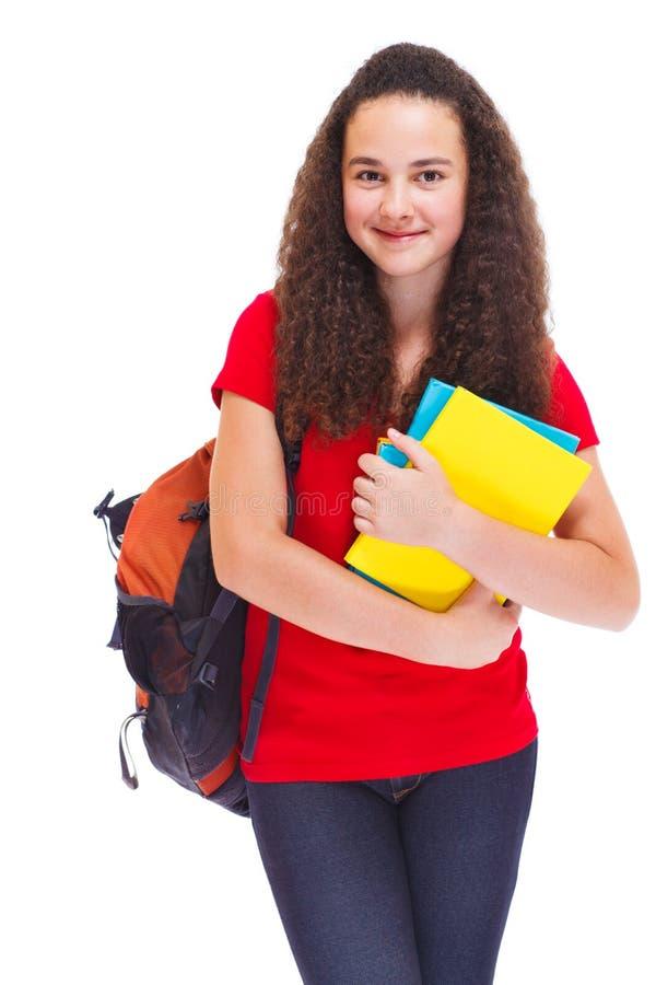 Meisje met boeken en schoolrugzak stock afbeeldingen