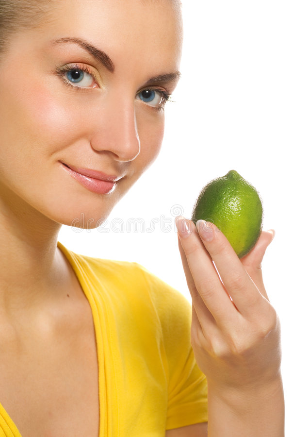 Meisje met citrusvrucht stock foto