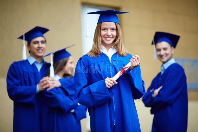 Meisje met diploma stock foto