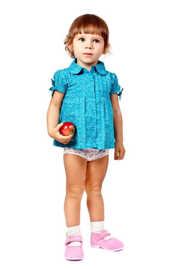 Meisje met een appel in geïsoleerdeo studio stock foto