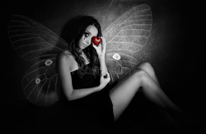 Meisje met een gebroken hart stock afbeelding