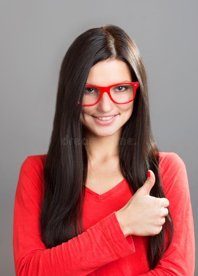 Meisje met een omhoog duim royalty-vrije stock afbeelding