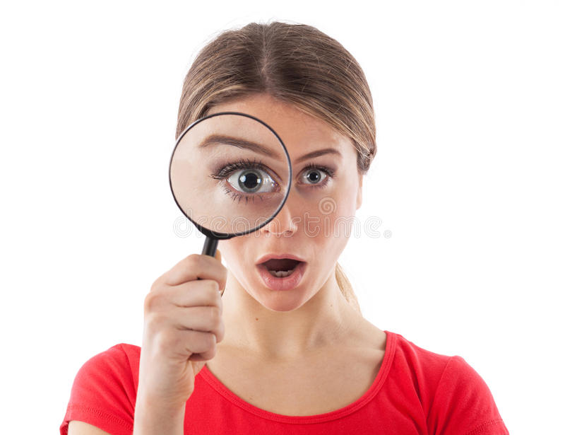 Meisje met een vergrootglas stock fotografie