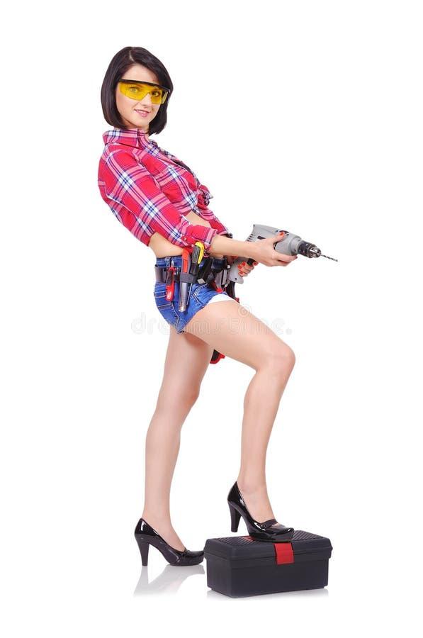 Meisje met elektrische boor stock afbeeldingen