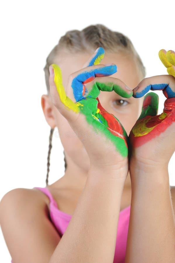 Meisje met geschilderde handen. stock afbeeldingen