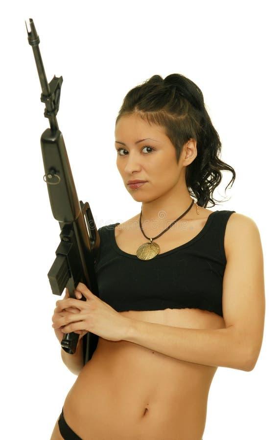 Meisje met geweer stock foto's