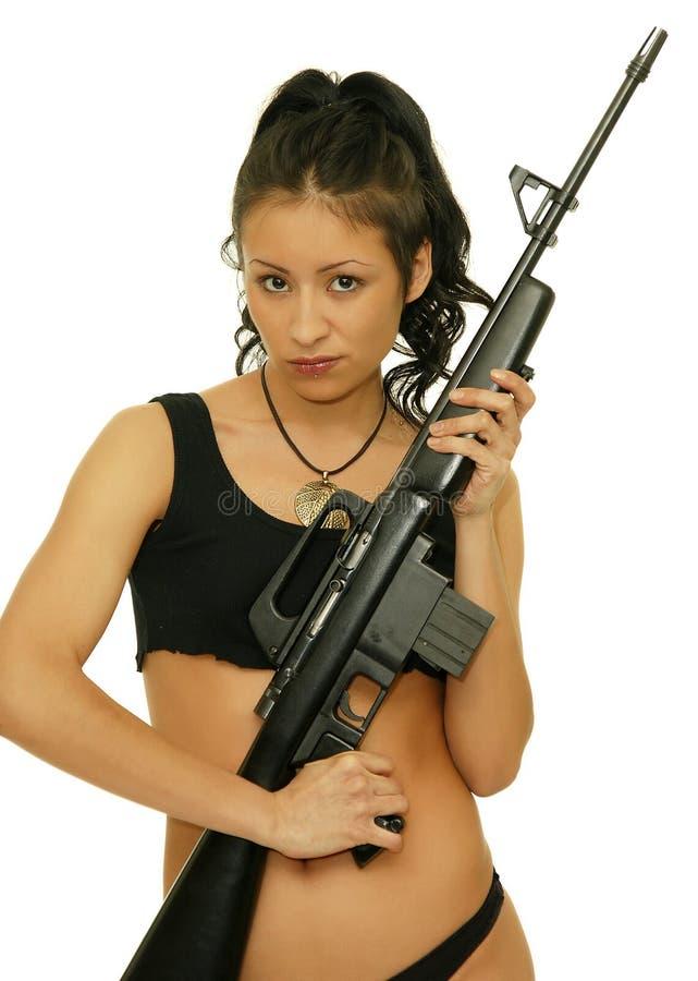 Meisje met geweer stock fotografie