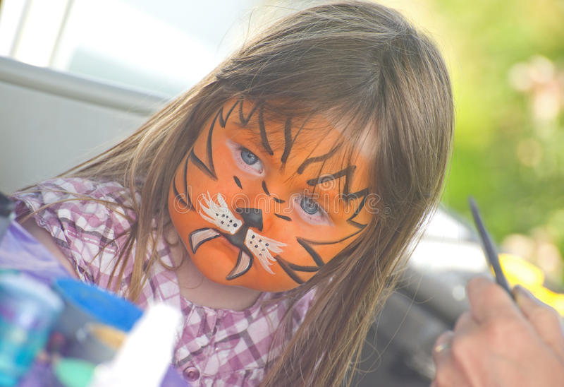 Meisje met gezicht het schilderen in Merkinch. royalty-vrije stock foto