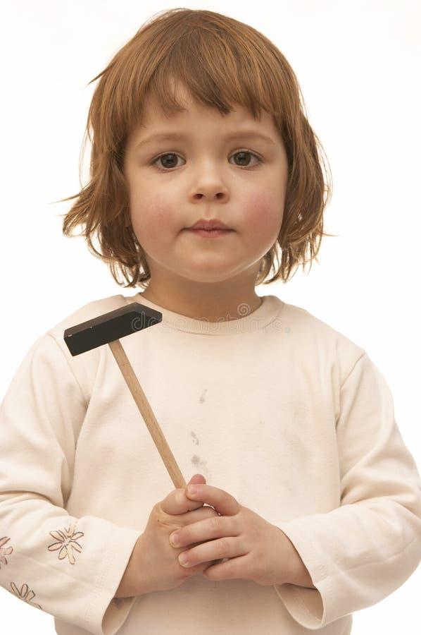 Meisje met hamer stock foto's