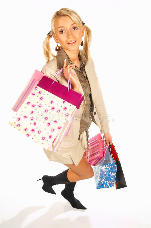 Meisje met handenhoogtepunt van zakken stock fotografie