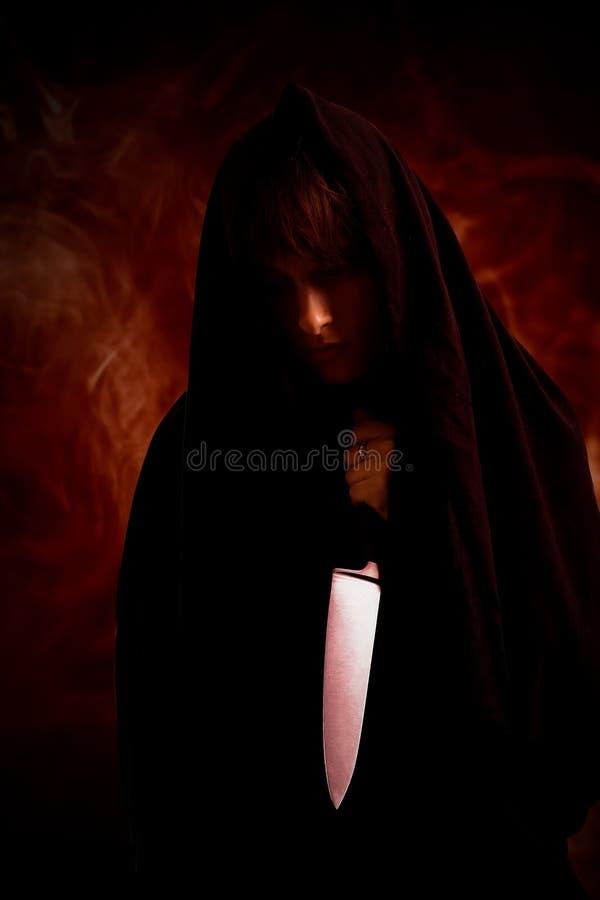 Meisje met het mes stock afbeeldingen