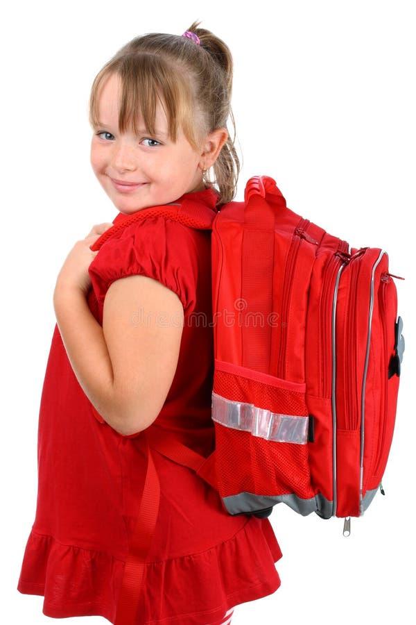 Meisje met het rode schooltas glimlachen geïsoleerdt op wit royalty-vrije stock afbeelding
