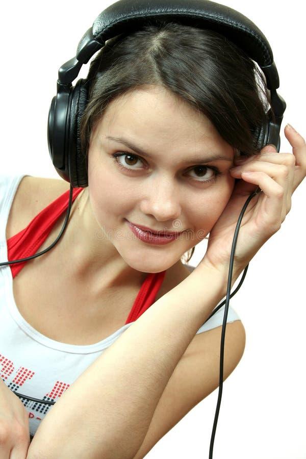 Meisje met hoofdtelefoon stock foto's
