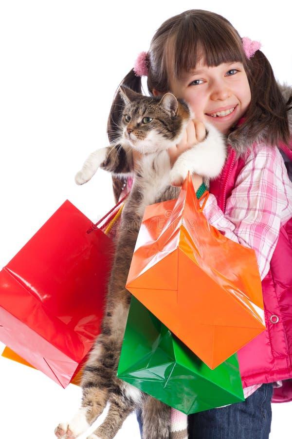 Meisje met katten en zakken royalty-vrije stock afbeelding
