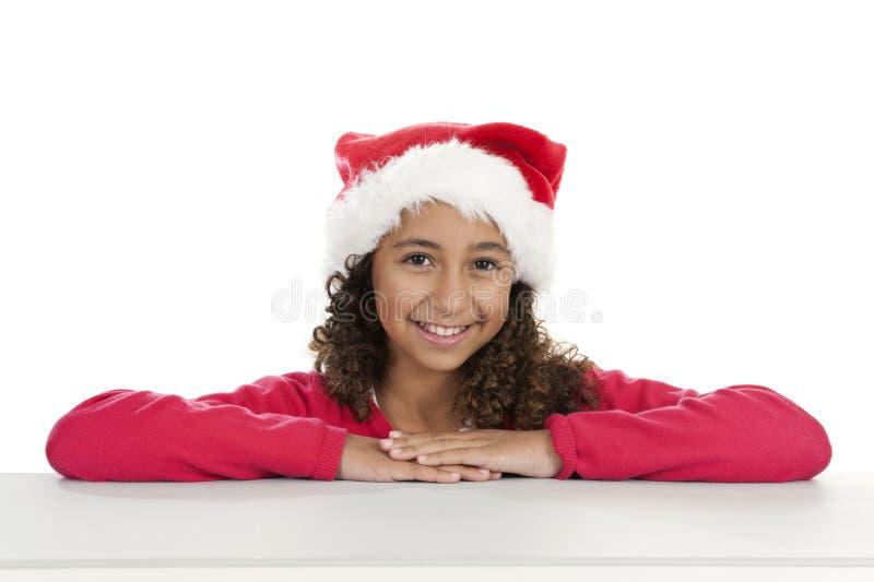 Meisje met Kerstmishoed op wit royalty-vrije stock foto's