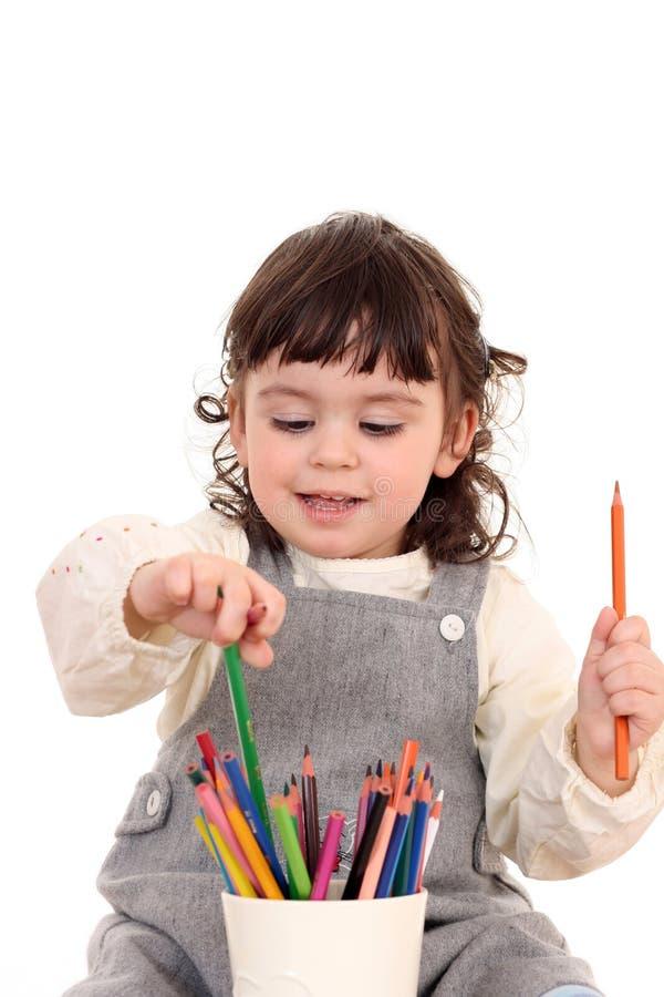 Meisje met kleurpotloden stock fotografie
