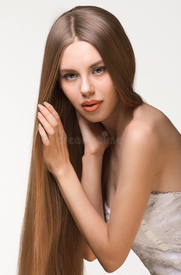 Meisje met lang blond haar royalty-vrije stock afbeelding