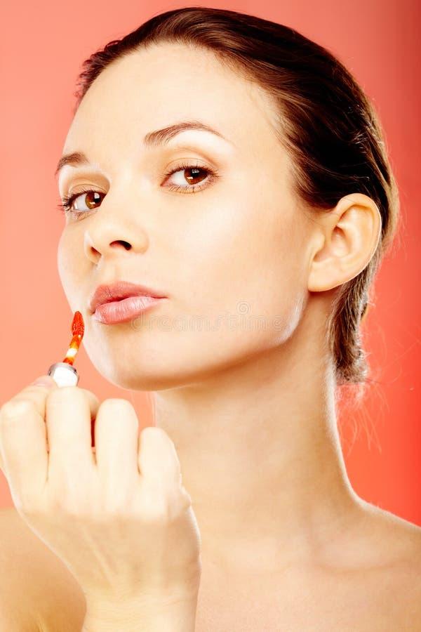 Meisje met lipgloss royalty-vrije stock afbeelding