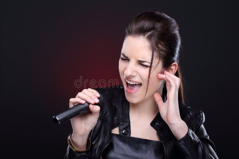 Meisje met microfoon stock fotografie