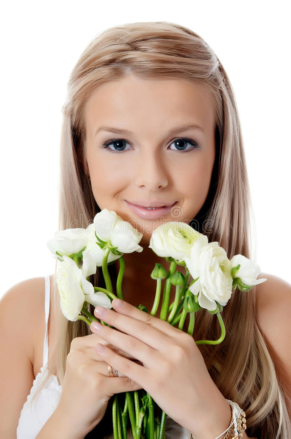 Meisje met mooi haar met bloem stock foto's