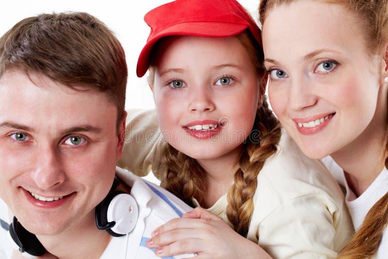 Meisje met ouders stock foto's