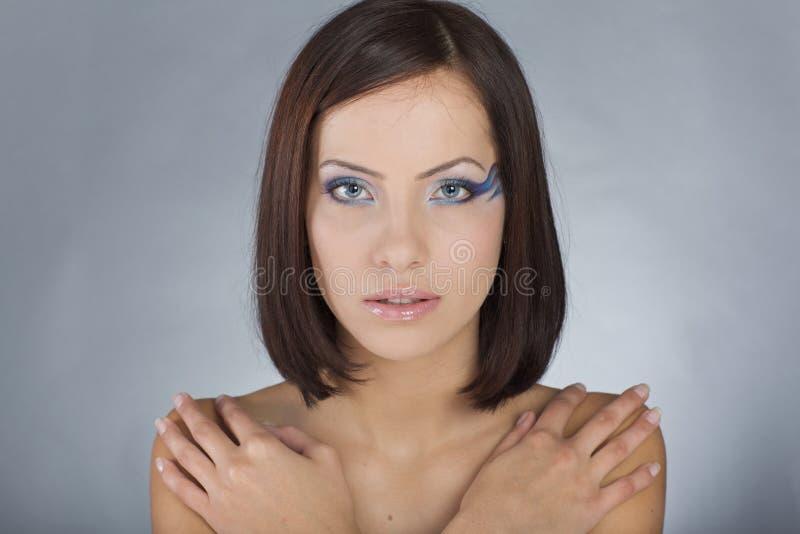Meisje met overzeese make-up stock foto's