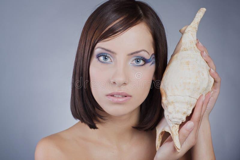 Meisje met overzeese make-up stock fotografie