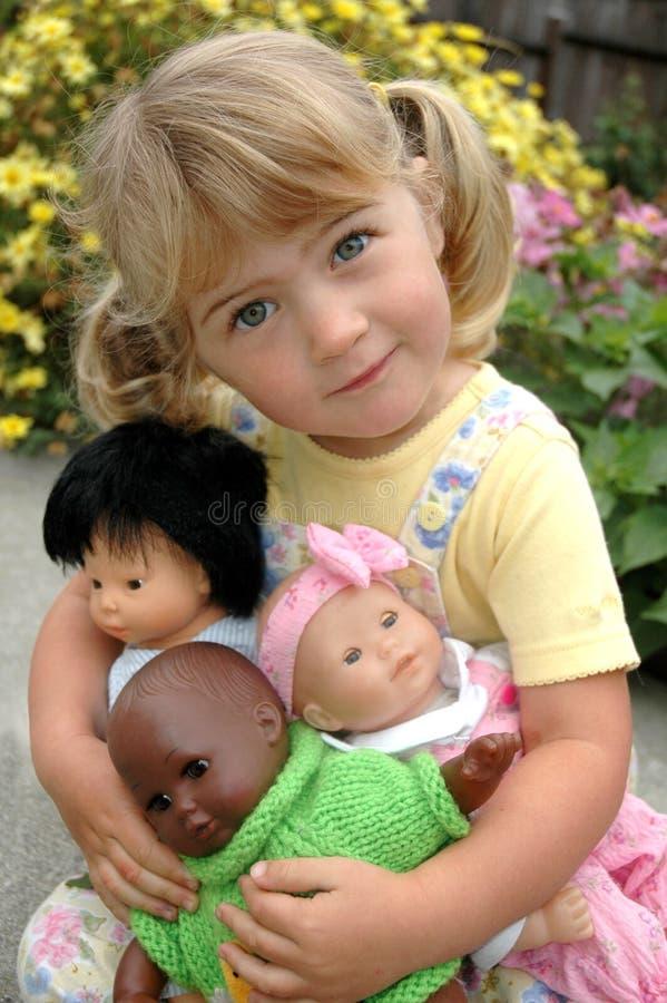 Meisje met poppen stock fotografie