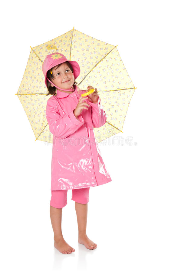 Meisje met regenjas en paraplu stock foto's