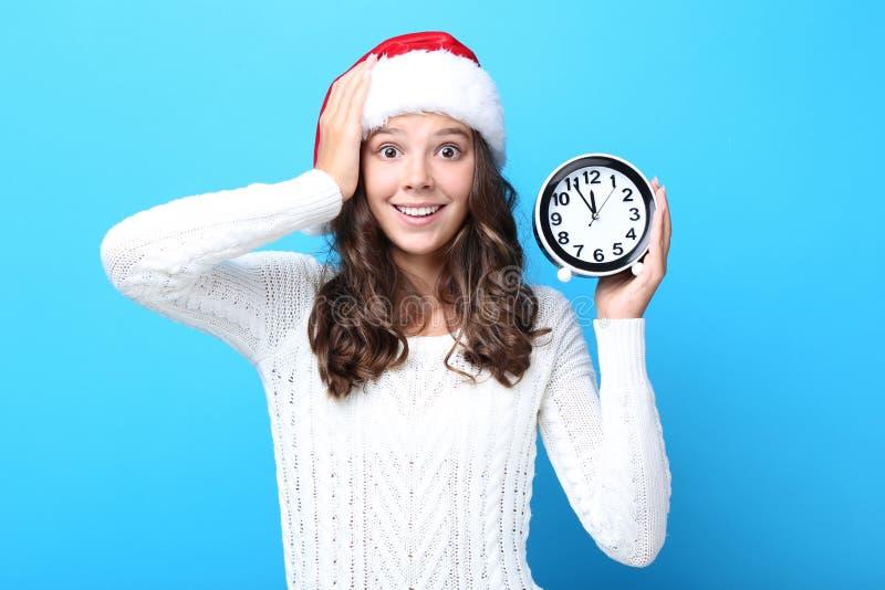 Meisje met ronde klok royalty-vrije stock afbeelding