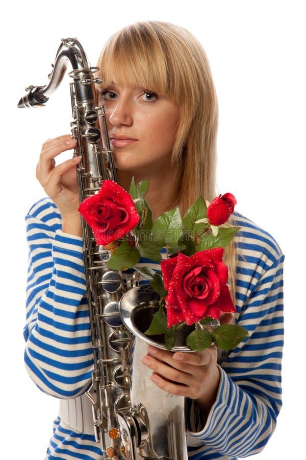 Meisje met saxofoon stock foto's