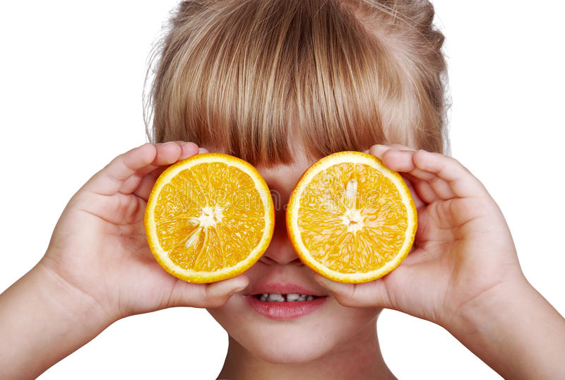 Meisje met sinaasappel stock foto's