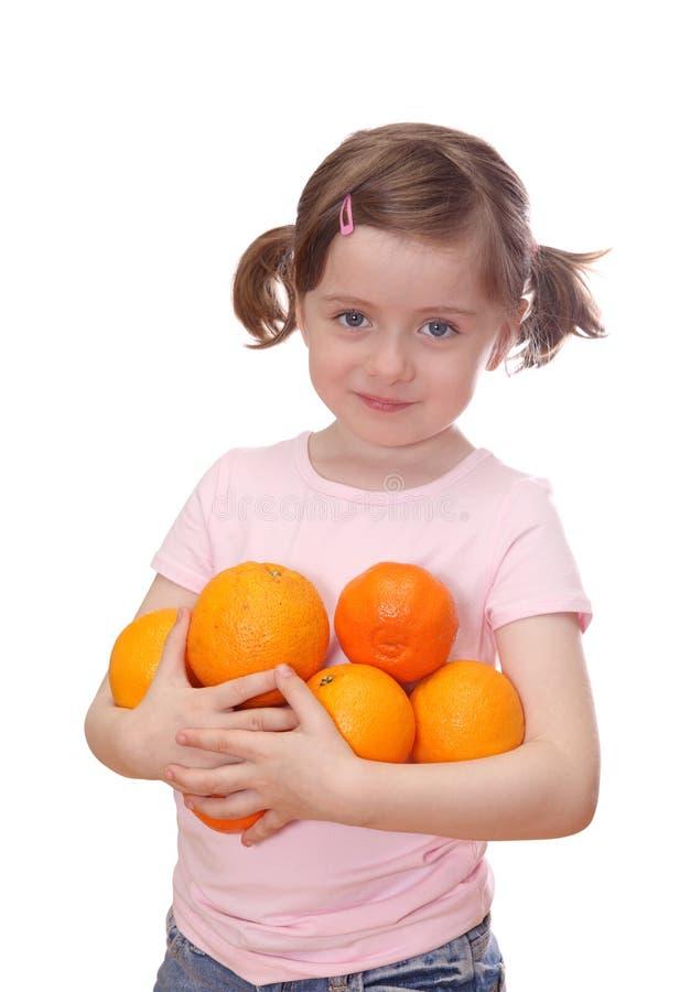Meisje met sinaasappelen royalty-vrije stock foto