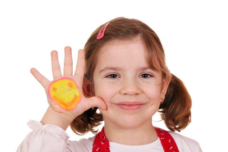 Meisje met smiley op handportret stock afbeeldingen