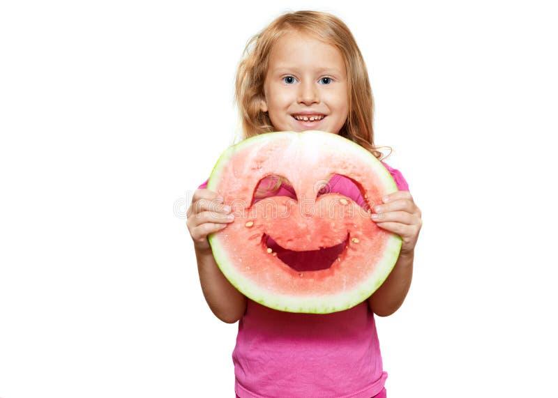 Meisje met smiley van watermeloen stock fotografie