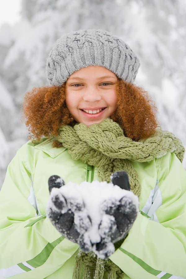 Meisje met sneeuw stock afbeeldingen