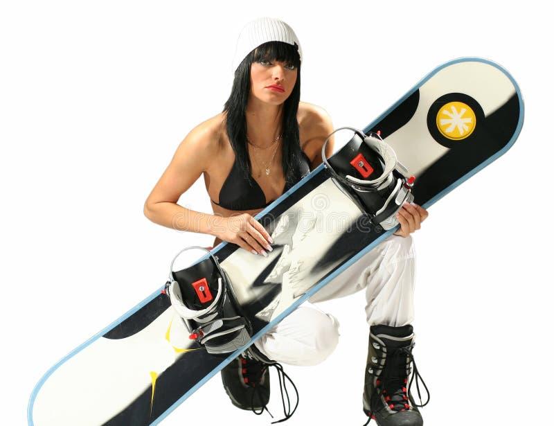 Meisje met snowboard stock afbeelding