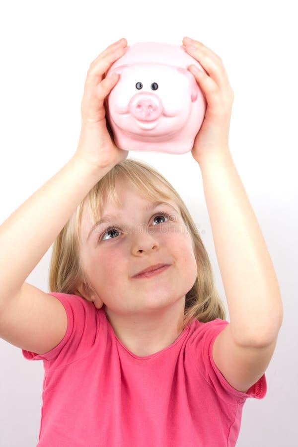 Meisje met Spaarvarken stock afbeelding