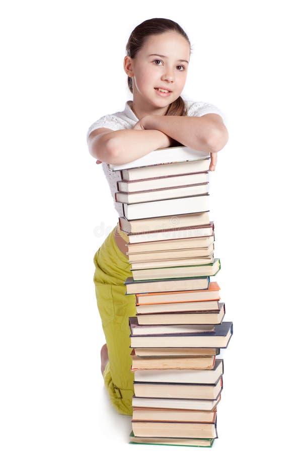 Meisje met Stapel Boeken stock afbeelding