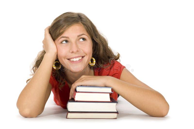 Meisje met stapel boeken stock foto's