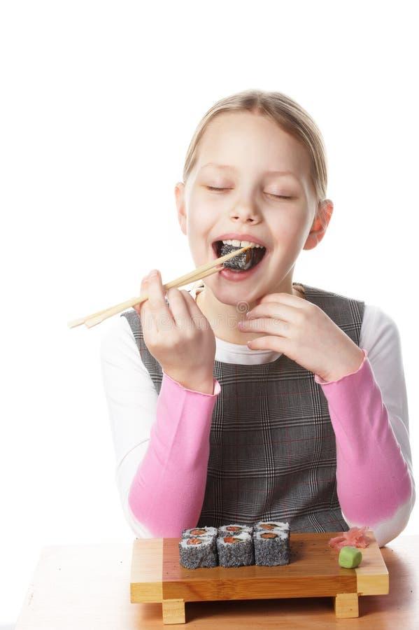 Meisje met sushi stock foto's