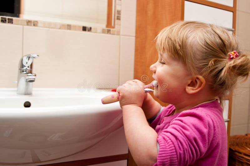 Meisje met tandenborstel stock afbeeldingen