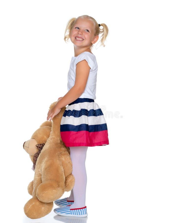 Meisje met teddybeer stock afbeelding