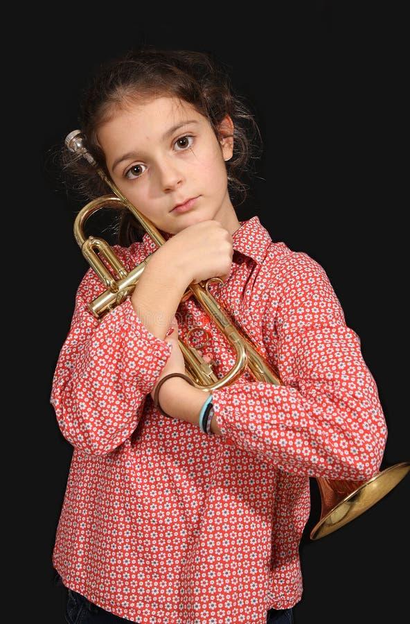 Meisje met trompet royalty-vrije stock afbeeldingen