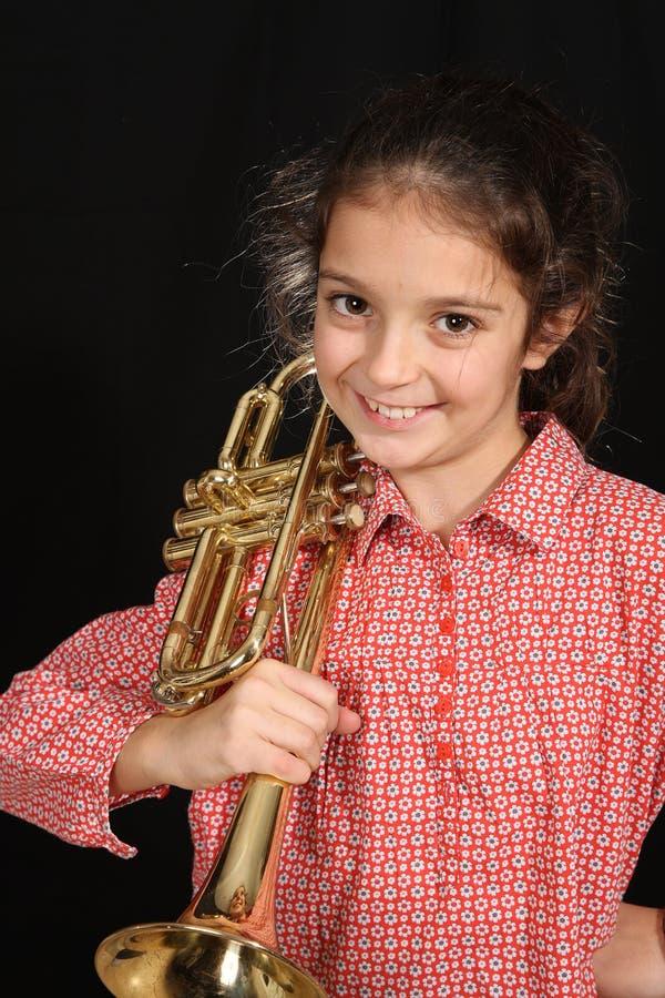 Meisje met trompet royalty-vrije stock foto