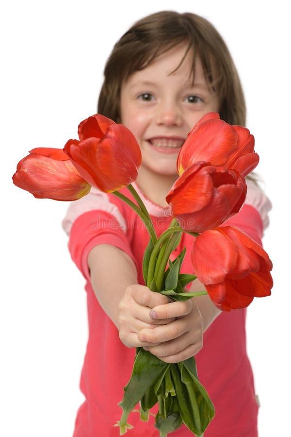 Meisje met tulpen stock fotografie
