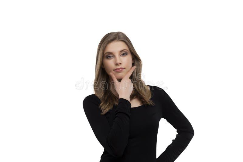 Meisje met twijfelachtige uitdrukking stock fotografie